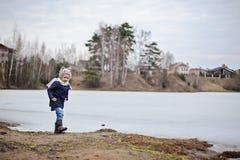 Child girl walking on frozen lake Stock Image