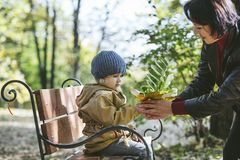 Child girl warm jacket and cap c grandmother in autumn Stock Photography