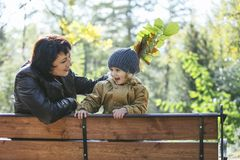 Child girl warm jacket and cap c grandmother in autumn Royalty Free Stock Photography