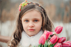 Child girl on warm winter forest walk, soft toned Royalty Free Stock Images