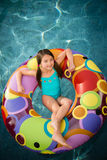 Child girl water inner tube Stock Photo