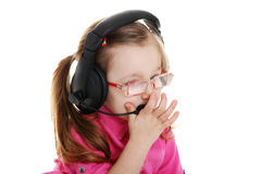 Child girl wearing a headset Royalty Free Stock Photography