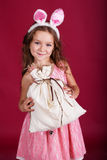 Child girl is wearing pink ears, christmas time Stock Photography