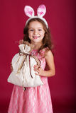 Child girl is wearing pink ears, christmas time Royalty Free Stock Images