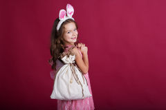 Child girl is wearing rabbit ears, christmas time Royalty Free Stock Image