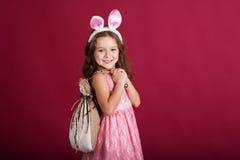 Child girl is wearing rabbit ears, christmas time Stock Image