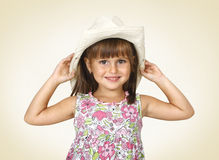 Child girl wearing white hat. Child girl wearing white cowboy hat and smiling Royalty Free Stock Photos