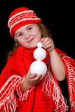 A child girl wearing winter clothes is holding a l Stock Photos