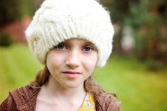 Child girl in white cap, close-up portrait Royalty Free Stock Image