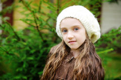 Child girl in white cap, close-up portrait Stock Image