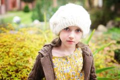 Child girl in white cap, close-up portrait Royalty Free Stock Photography