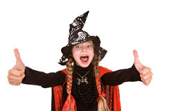 Child girl witch in black costume  with thumb. Royalty Free Stock Photo