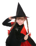 Child girl witch in black costume  with thumb. Stock Photography