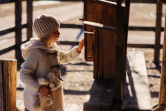Child girl with wooden bird houses on country side Stock Photos