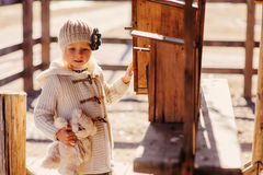 Child girl with wooden bird houses on country side Royalty Free Stock Photos