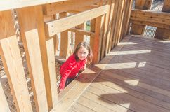 Girl on a wooden Playground in the form of a pirate ship. A child, a girl on a wooden Playground in the form of a pirate ship royalty free stock photography