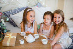Child girls wake up in her bed in Christmas morning Royalty Free Stock Photos