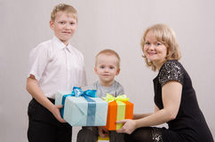 Child give gifts. Five children give gifts mother and brother royalty free stock photography
