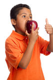 Child Gives One Thumb Up for Apples Royalty Free Stock Image