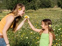 Child giving gift of flowers Stock Photos