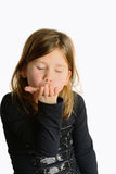 Child giving hand kisses Stock Images