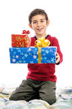 Child giving present at Christmas Royalty Free Stock Photo