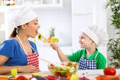 Child giving to his mother fresh healthy food Royalty Free Stock Photography