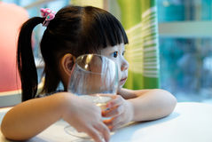 Child and glass Royalty Free Stock Photo