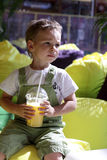 Child with glass of fresh juice Stock Photos