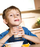 Child with glass of milk Stock Photo