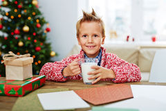 Child with glass of milk Royalty Free Stock Image