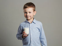 Child with glass of milk.Little Boy enjoy milk cocktail. Healthy life royalty free stock photo