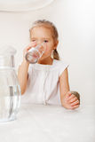 Child with glass pitcher water Stock Photo