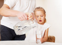 Child with glass pitcher water Royalty Free Stock Image