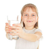 Child with a glass of pure water Stock Images