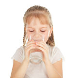 Child with a glass of pure water Royalty Free Stock Photos