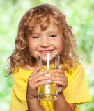 Child with a glass of water Royalty Free Stock Photos