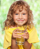 Child with a glass of water Stock Image