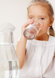 Child with glass water Royalty Free Stock Photography