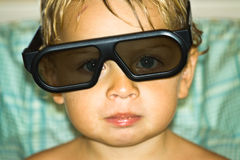 Child with glasses. Portrait of a toddler with 3D glasses Royalty Free Stock Photos