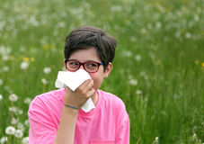 Child with glasses blows his nose Royalty Free Stock Photography