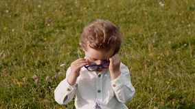 Child in glasses stock footage
