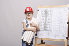Child with glasses costs drawings at Board Royalty Free Stock Photo