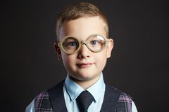 Child in glasses. little boy in suit Stock Images