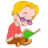 Child in glasses reading a book Stock Photo