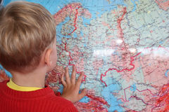 Child and globe Royalty Free Stock Images