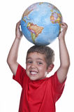 Child with a globe. On his head Royalty Free Stock Image