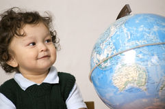 Child with globe. Royalty Free Stock Images