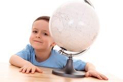 Child and globe Royalty Free Stock Photos