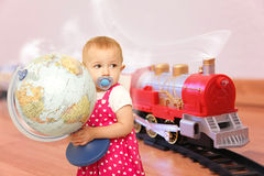 Child with globe wants trip on train Royalty Free Stock Photos